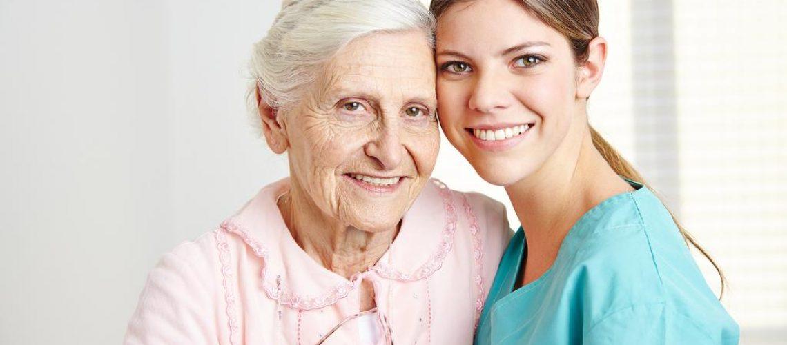 bigstock-Smiling-caregiver-embracing-ha-54611003